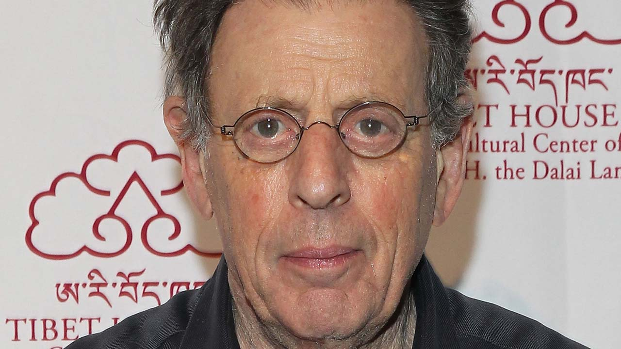(FILES) This file photo taken on March 5, 2015 shows Co-founder and president of Tibet House New York, Philip Glass, attending the Tibet House Benefit Concert After Party 2015 at Metropolitan West on March 6, 2015 in New York City. Leading contemporary composer Philip Glass is celebrating his 80th birthday with a season that will bring a range of his music to Carnegie Hall, the venue announced on January 25, 2017. Astrid Stawiarz / GETTY IMAGES NORTH AMERICA / AFP