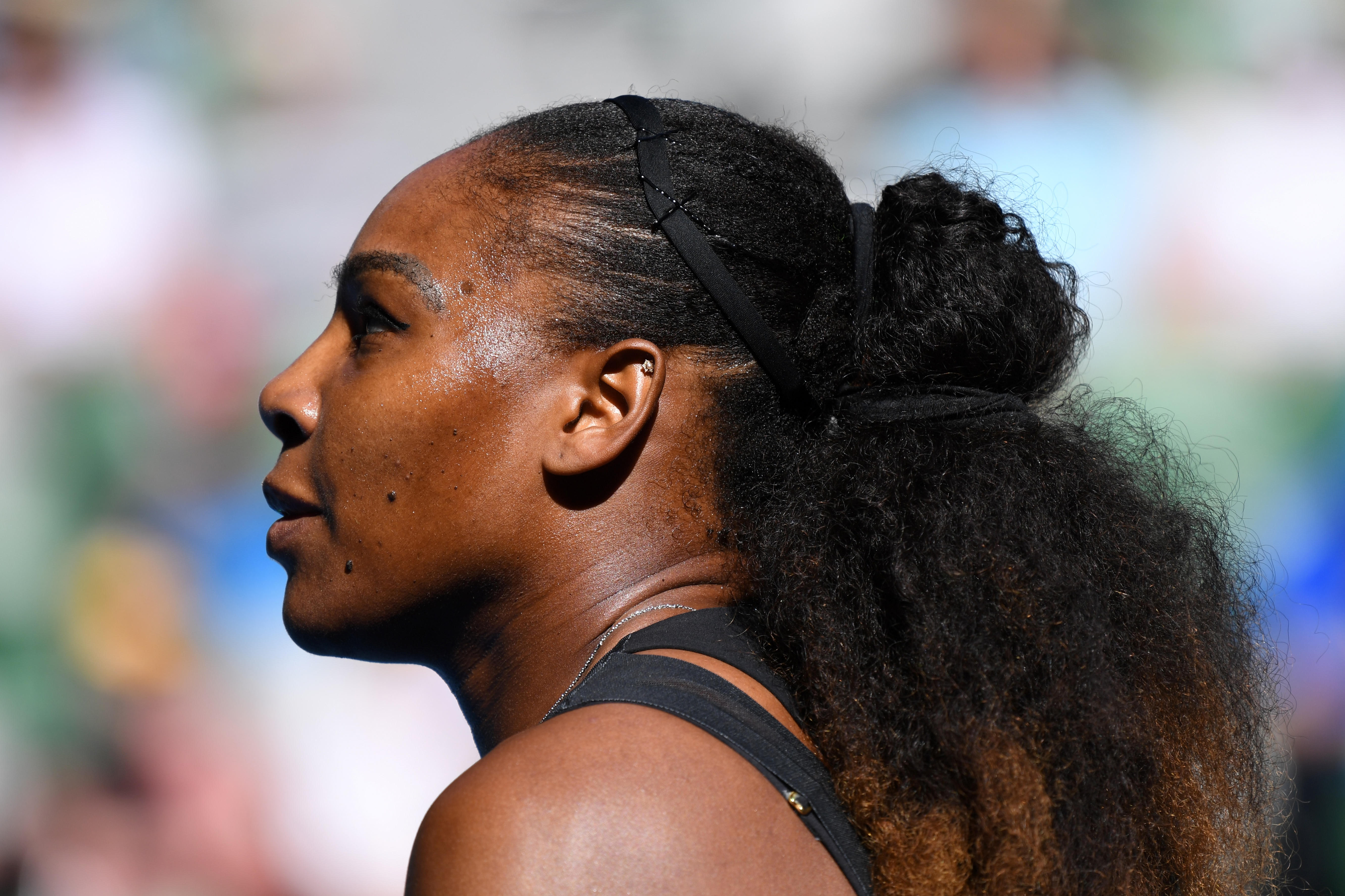 Serena Williams of the US looks on while playing against Croatia's Mirjana Lucic-Baroni during their women's singles semi-final match on day 11 of the Australian Open tennis tournament in Melbourne on January 26, 2017. / AFP PHOTO / GREG WOOD /
