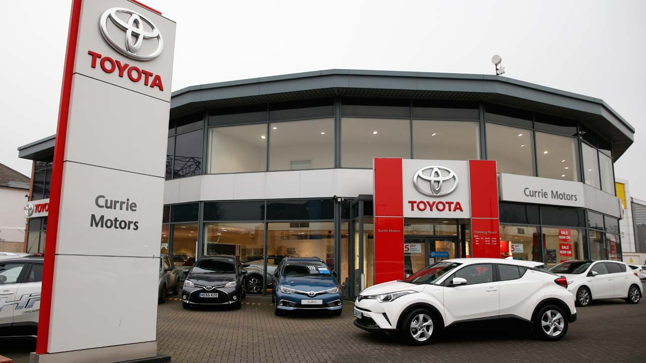 Brand new Toyota cars sit on the forecourt of Currie Motors Toyota dealership in Twickenham, west London, on January 26, 2017. Britain's car industry reached its highest production level of the 21st century last year, but with Brexit talks imminent manufacturers are facing uncertain times ahead of the country's EU exit. Car production has driven through economic downturns in the UK and taken off in recent years, with this decade set to be the best the sector has seen since the 1970s. There has been a wave of investment in the country from foreign carmakers, notably Japanese firms Nissan, Toyota and Honda, which between them produce half the cars made in Britain. PHOTO: Adrian DENNIS / AFP