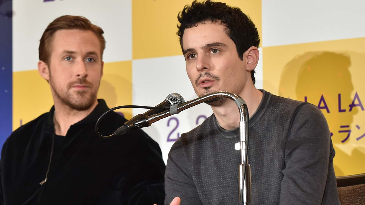 "US film director Damien Chazelle (R) answers questions as Canadian actor Ryan Gosling (L) looks on during a press conference for their film ""La La Land"" in Tokyo on January 27, 2017. Romantic showbiz musical ""La La Land"" topped the Oscars nominations list on January 25 with a whopping 14 nods, tying an all-time record. KAZUHIRO NOGI / AFP"