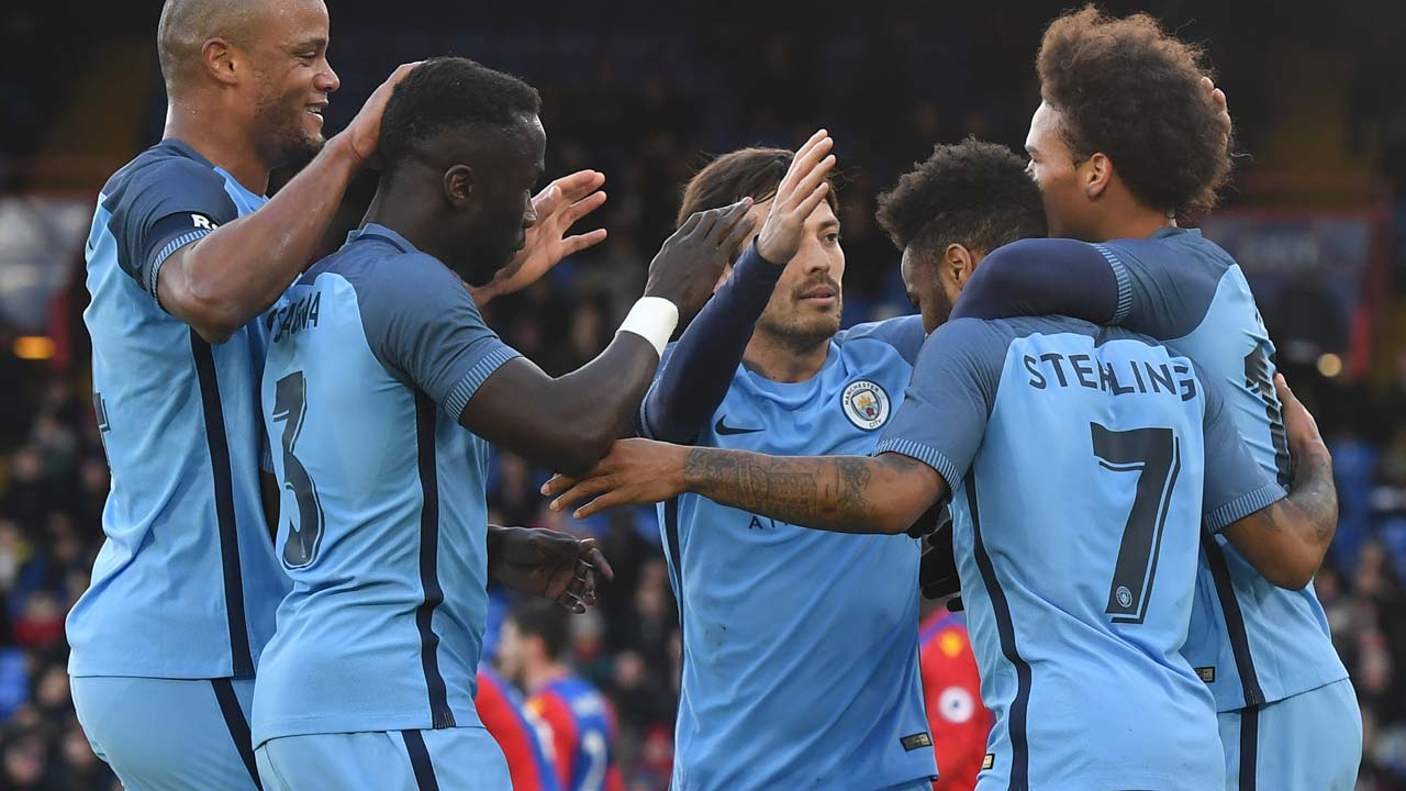Manchester City's English midfielder Raheem Sterling (2R) celebrates scoring the opening goal with team-mates during the English FA Cup fourth round football match between Crystal Palace and Manchester City at Selhurst Park in south London on January 28, 2017. PHOTO: Ben STANSALL / AFP