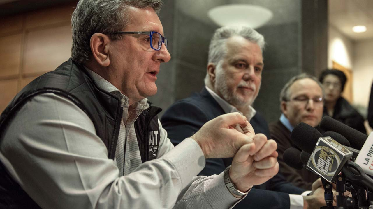 L-R: Régis Labeaume Quebec city mayor, Philippe Couillard Quebec prime minister and Martin Coiteux minister of Public Security, hold a press conference following a shooting in a mosque at the Québec City Islamic cultural center in Quebec city on January 30, 2017 Two arrests have been made after five people were reportedly shot dead in an attack on a mosque in Québec City, Canada. PHOTO: Alice Chiche / AFP