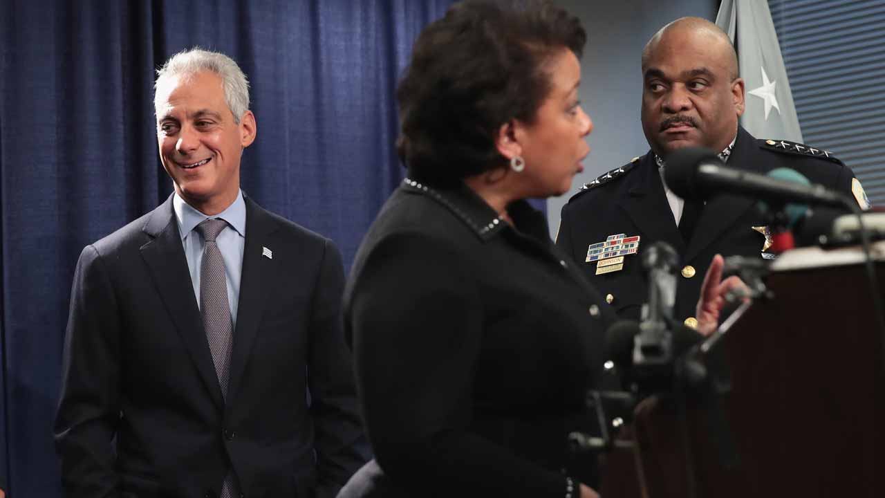 CHICAGO, IL - JANUARY 13: Chicago Mayor Rahm Emanuel (R) and Police Superintendent Eddie Johnson (L) listen as U.S. Attorney General Loretta Lynch speaks at a press conference on January 13, 2017 in Chicago, Illinois. Lynch called the press conference to announce the release of a report which cited widespread abuses by officers in the Chicago police department following a 13-month investigation. Scott Olson/Getty Images/AFP SCOTT OLSON / GETTY IMAGES NORTH AMERICA / AFP