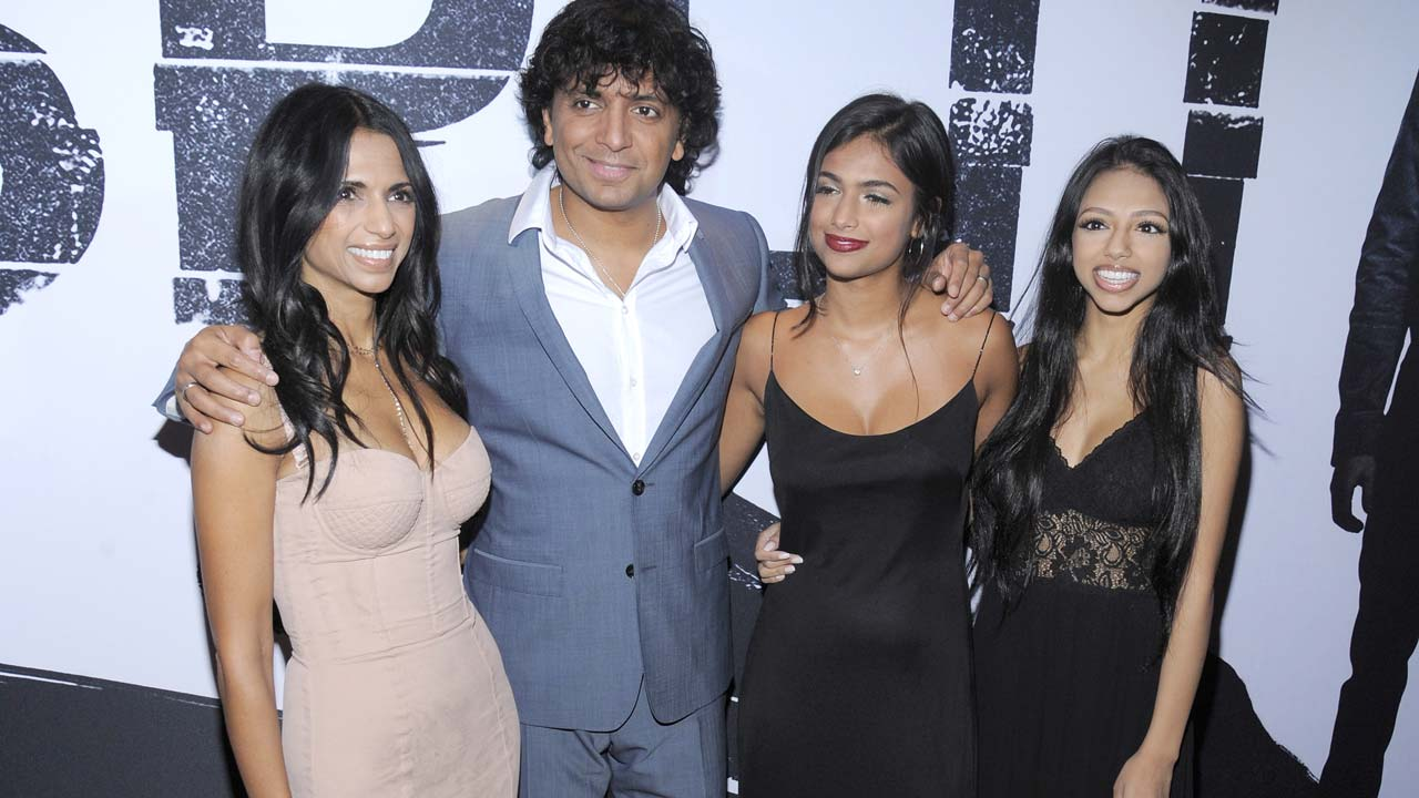 """NEW YORK, NY - JANUARY 18: Director, writer, producer M. Night Shyamalan and Bhavna Vaswani and daughters attend """"Split"""" New York Premiere at SVA Theater on January 18, 2017 in New York City. Matthew Eisman/Getty Images/AFP Matthew Eisman / GETTY IMAGES NORTH AMERICA / AFP"""