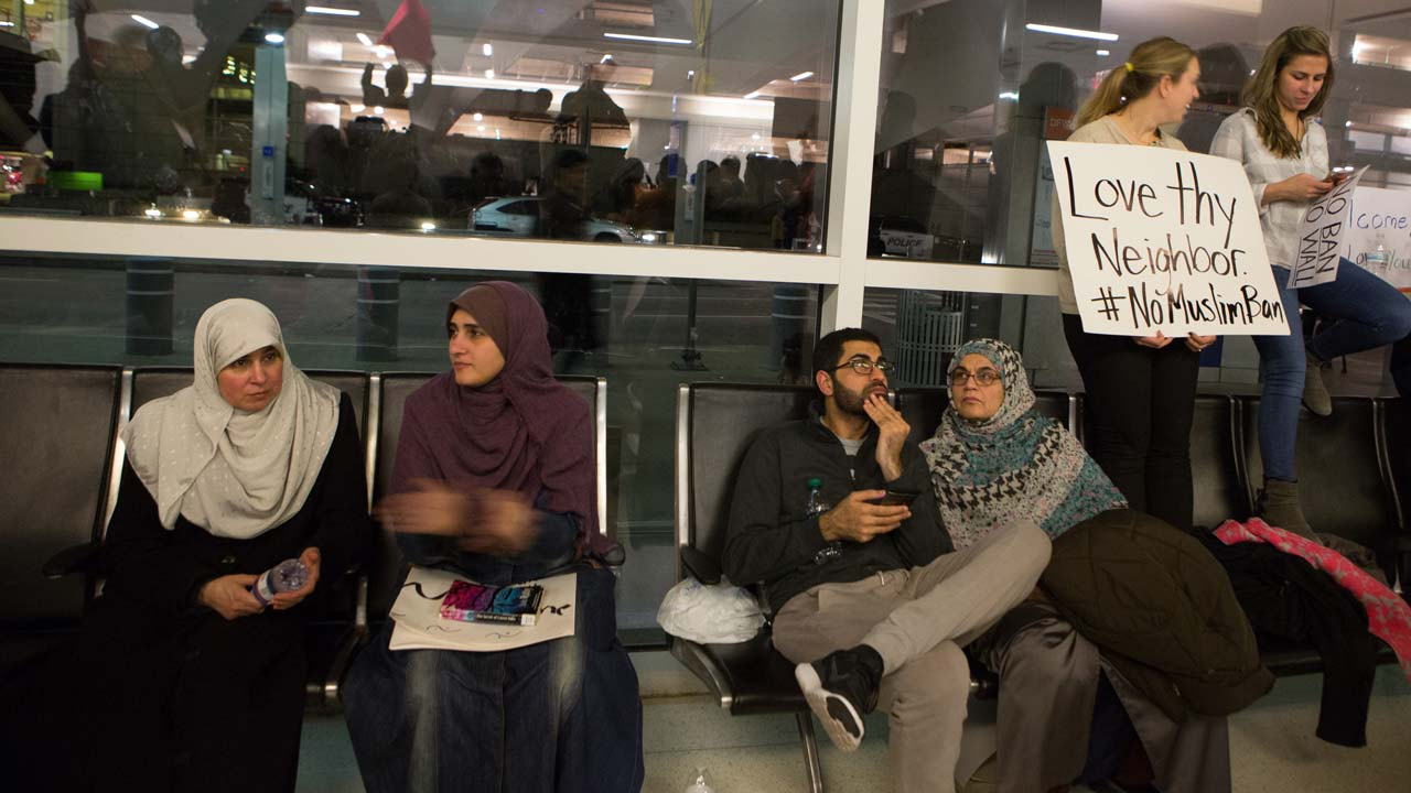 Protesters gather to denounce President Donald Trump's executive order that bans certain immigration, at Dallas-Fort Worth International Airport on January 28, 2017 in Dallas, Texas. President Trump signed the controversial executive order that halted refugees and residents from predominantly Muslim countries from entering the United States. G. Morty Ortega/Getty Images/AFP  G. Morty Ortega / GETTY IMAGES NORTH AMERICA / AFP