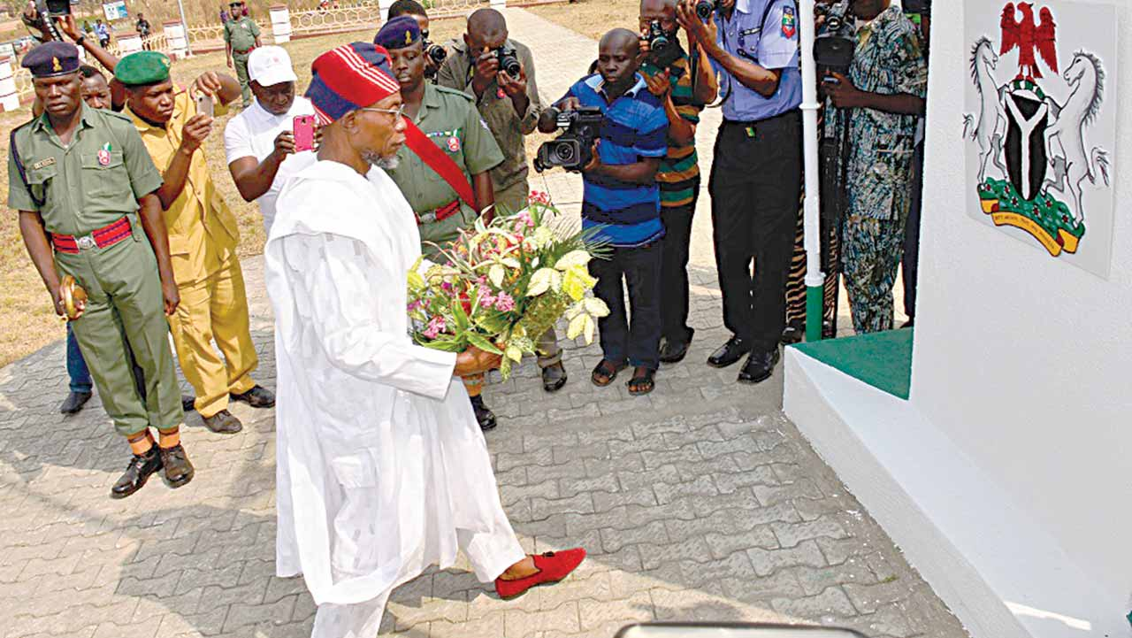Governor Ogbeni Rauf Aregbesola of Osun at the New Military Cenotaph in front of state's House of Assembly in Osogbo.