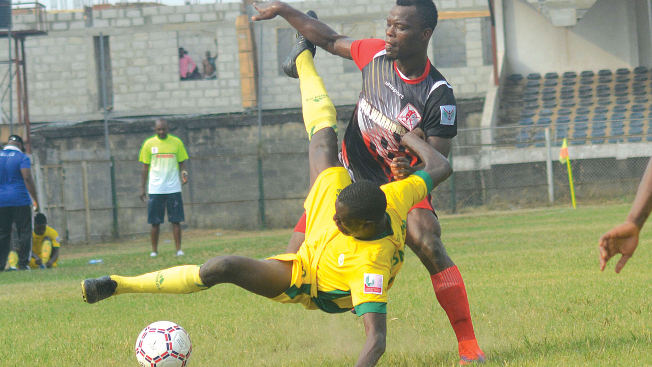 Abia Warriors' Emeka Isaac (right) battles with Katsina United's Usman during their Week Two match in Umuahia. The Okey Emordi-led team have been fined for their misdemeanor during their Week Three game against Remo Stars…at the weekend. PHOTO: LMC