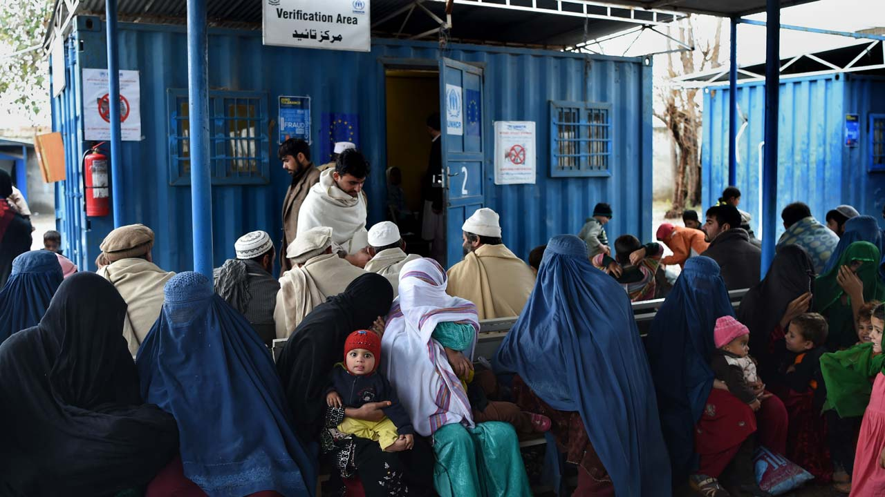 Afghan refugees wait to update their family data at the UNHCR Verification Center in Chamkani, on the outskirts of Peshawar on January 26, 2017. More than 380,000 registered Afghan refugees returned from Pakistan in 2016. ABDUL MAJEED / AFP