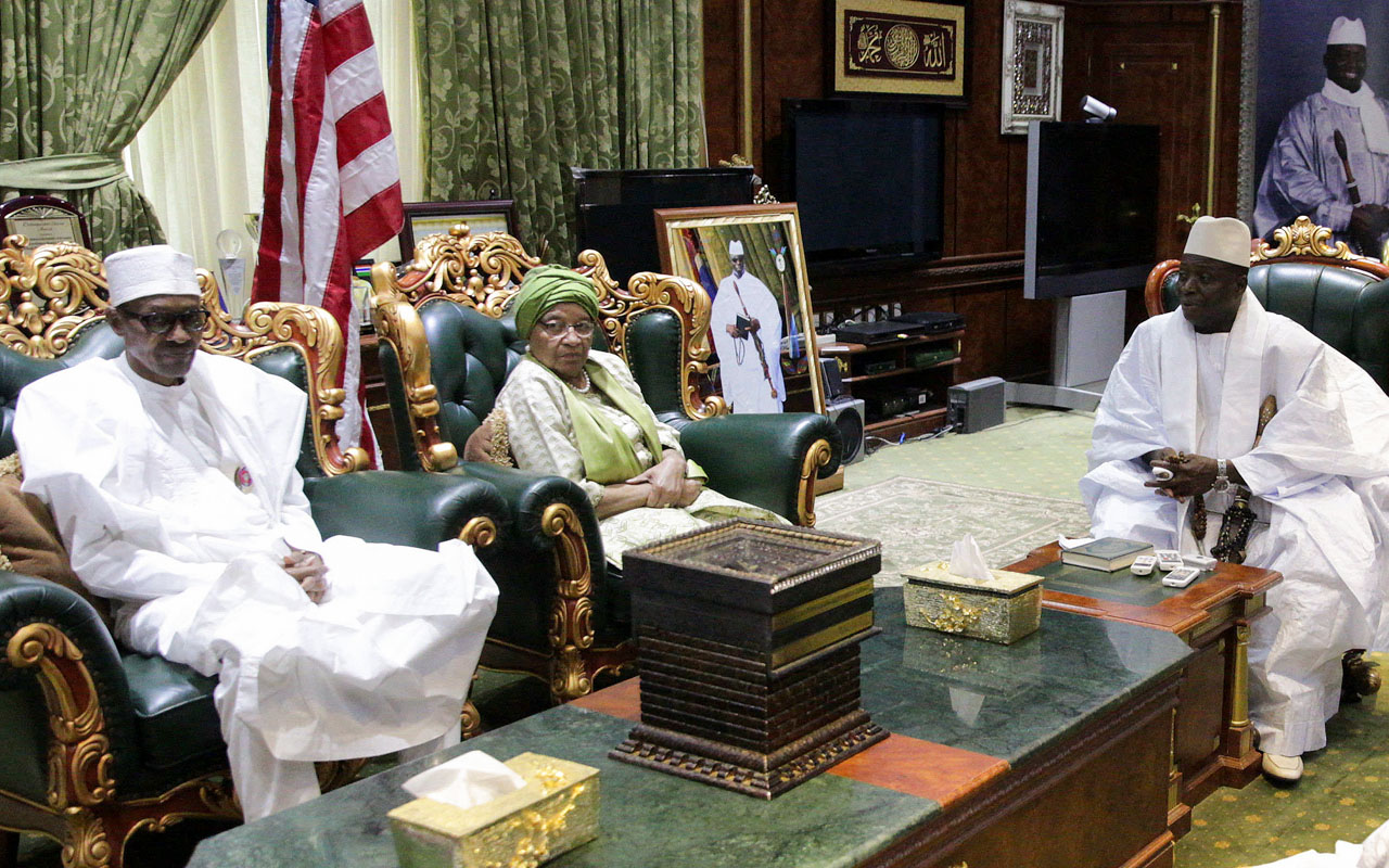 A handout picture released by the Nigerian Presidency on January 13, 2017 shows Nigerian President Muhammadu Buhari (L) and Liberian President Ellen Johnson Sirleaf meeting Gambian President Yahya Jammeh (R) in Banjul. West African leaders began crisis talks with President Yahya Jammeh on January 13 over his refusal to leave power, as fears grew of a refugee exodus caused by the nation's political impasse. Nigerian President Muhammadu Buhari is leading the three-nation delegation that includes Ghana's former president John Mahama and Liberian leader Ellen Johnson Sirleaf, who attempted similar negotiations last month without success. / AFP PHOTO / NIGERIAN PRESIDENCY / Handout /