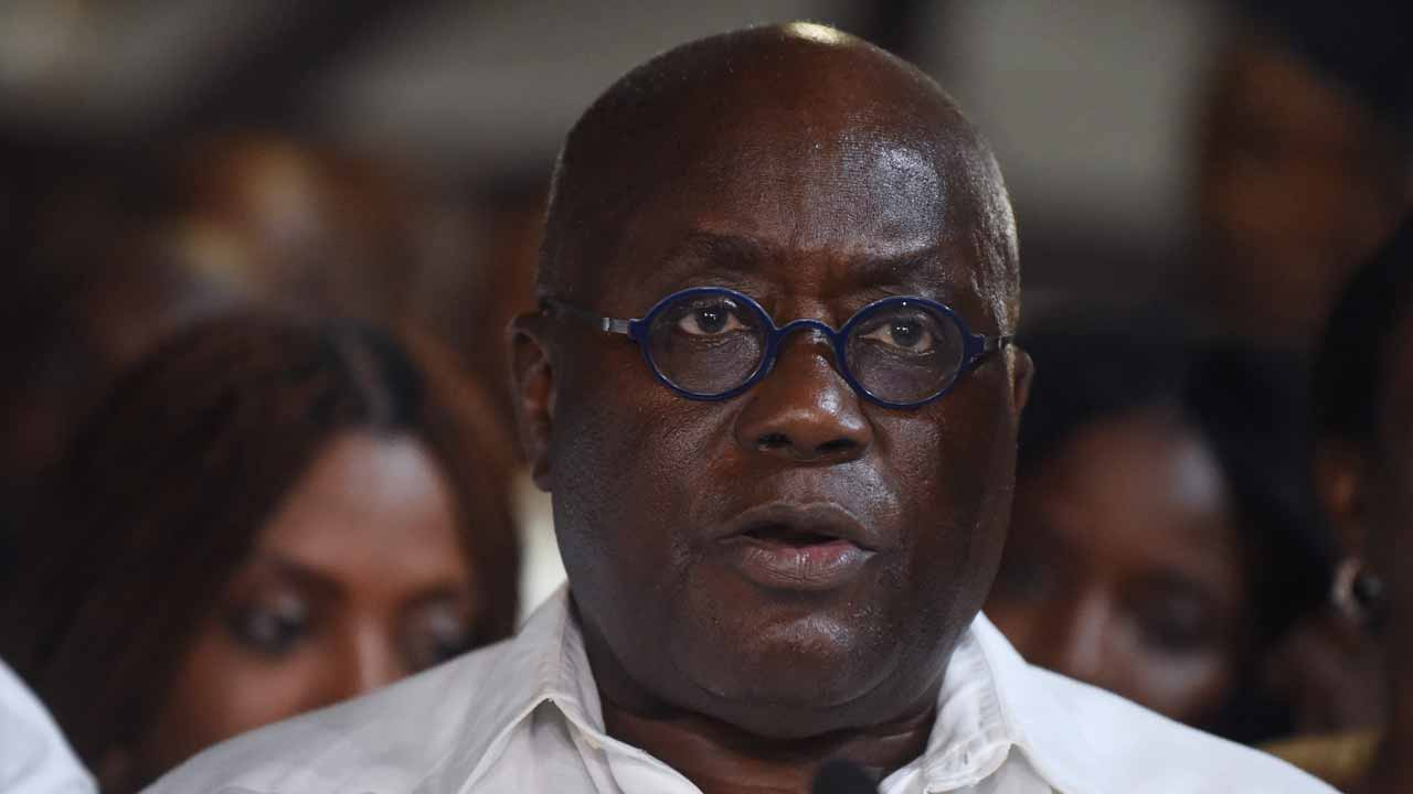 (FILES) This file photo taken on December 9, 2016 shows President-elect and candidate of the opposition New Patriotic Party Nana Akufo-Addo reading his acceptance speech after being declared elected by the Electoral Commission at the just concluded presidential elections in Accra. Nana Akufo-Addo is to be sworn in as Ghana's new president on January 7, 2016 after beating incumbent leader John Dramani Mahama in elections last month. Pius Utomi EKPEI / AFP
