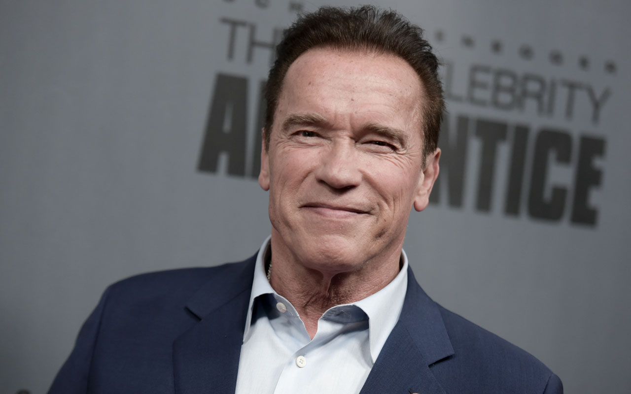 "(FILES) This file photo taken on December 9, 2016 shows Arnold Schwarzenegger as he attends ""The New Celebrity Apprentice"" Q & A and Red Carpet Event At Universal Studio, Universal City, California. When Donald Trump hosted ""The Celebrity Apprentice,"" he dismissed contestants with what became his indelible catchphrase: ""You're fired."" Now that Trump is poised to take over the White House, there is a new boss on the reality show. And Arnold Schwarzenegger isn't just firing people anymore. ""You're Terminated!"" the Hollywood star and former California governor said in Monday night's premiere of the show, now in its eighth season. / AFP PHOTO / RICHARD SHOTWELL"