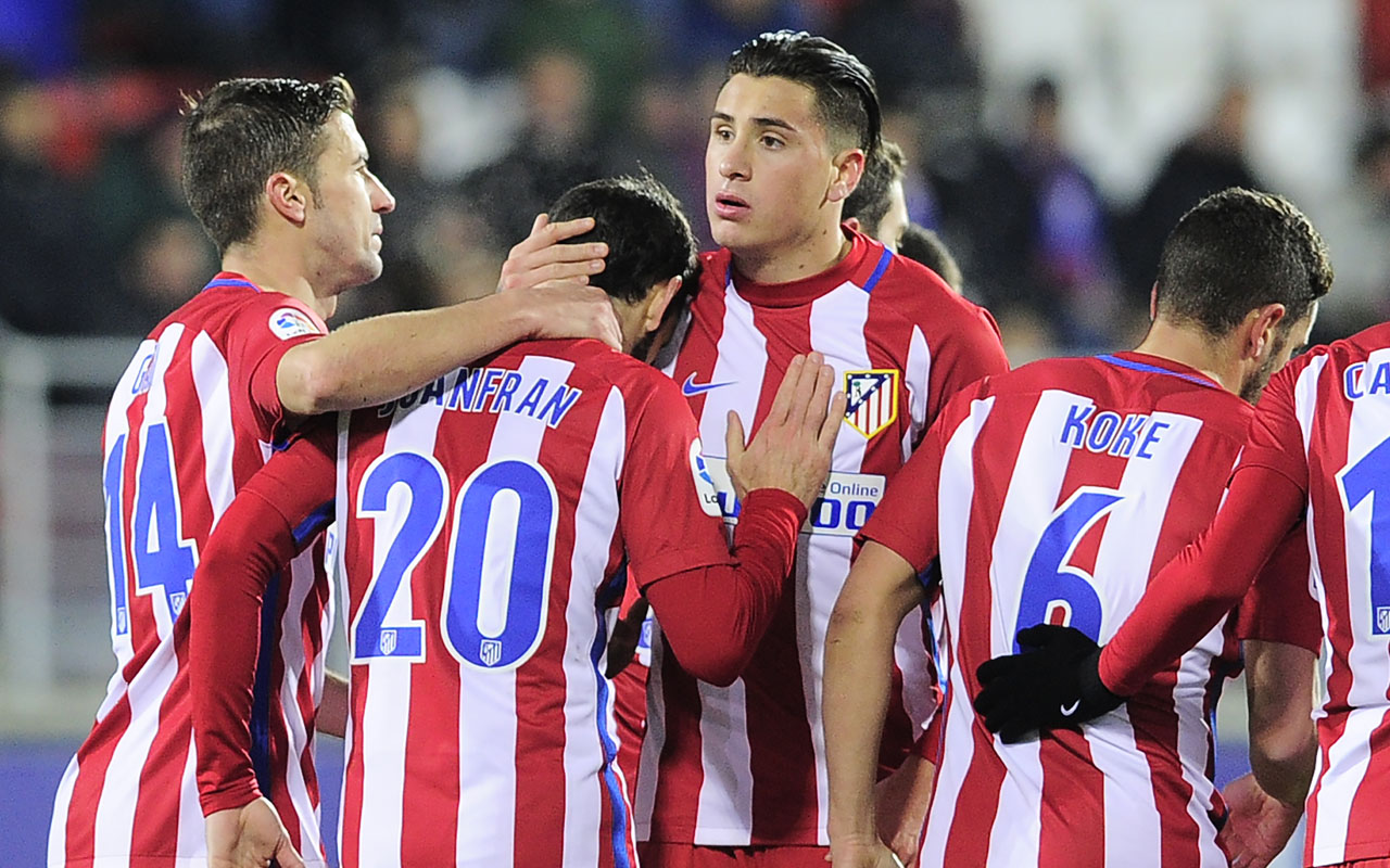 Atletico Madrid's players celebrate after defender Juanfran scored their team's second goal during the Spanish Copa del Rey (King's Cup) quarter final second leg football match SD Eibar vs Club Atletico de Madrid at the Ipurua Municipal stadium on January 25, 2017. / AFP PHOTO / ANDER GILLENEA