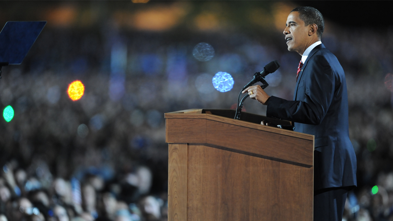 (FILES) This file photo taken on November 5, 2008 shows then Democratic presidential candidate Barack Obama as he addresses supporters during his election night rally at Grant Park in Chicago, Illinois. Barack Obama travels to Chicago for his farewell speech on January 10, 2017, returning to the town where his meteoric rise to become America's first black president all began. The third largest US city is also important to his post-presidency: it will be home to the Obama presidential library and foundation. / AFP PHOTO / JEWEL SAMAD