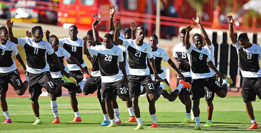 Ghana's  football players warm up during a training session. PHOTO:AFP