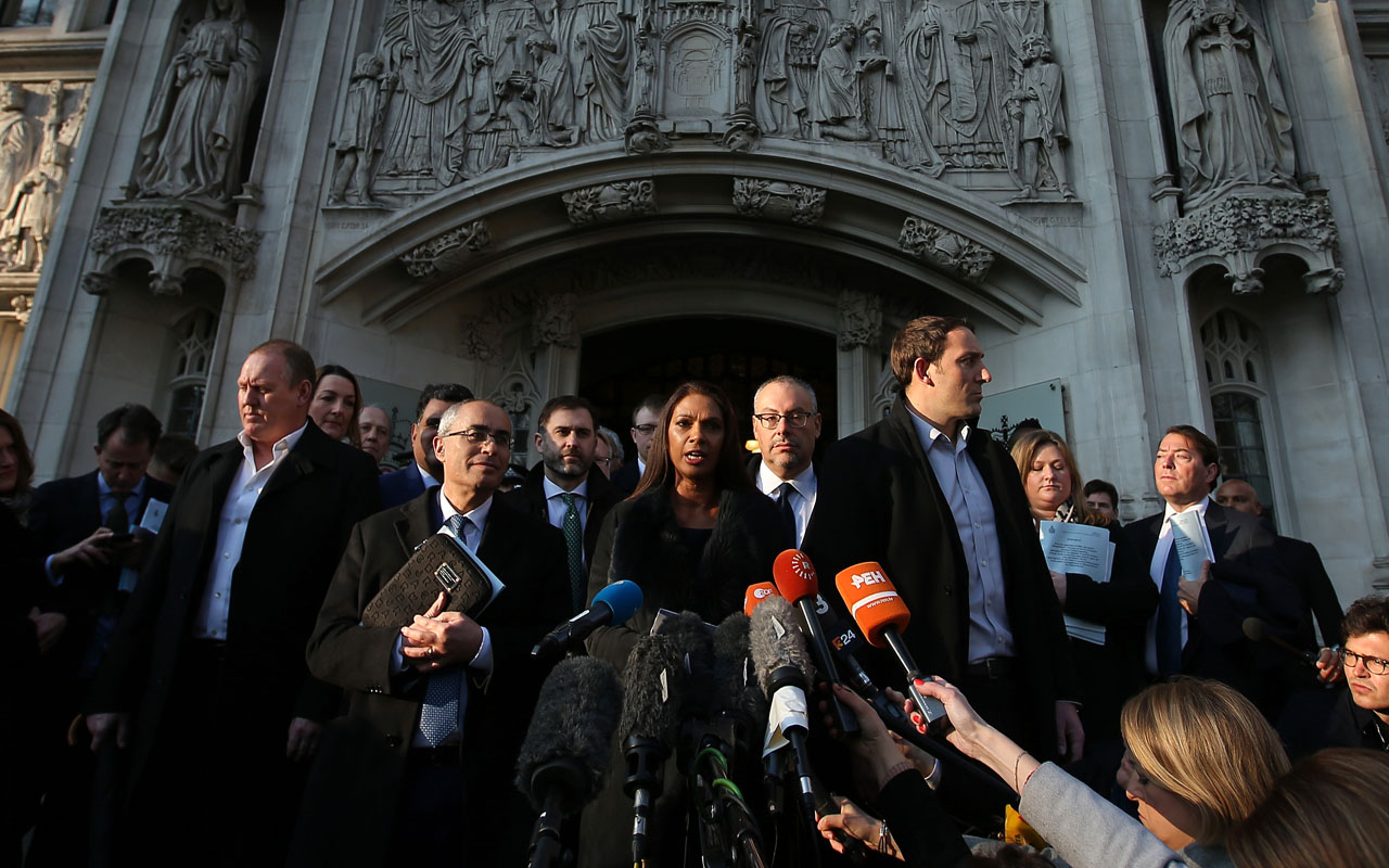 "Gina Miller, co-founder of investment fund SCM Private (C) makes a statement following the judgement in a case to decide whether or not parliamentary approval is needed before the government can begin Brexit negotiations, outside the Supreme Court, opposite the Houses of Parliament, in central London on January 24, 2017. Britain's Supreme Court ruled Tuesday that the government must obtain the approval of parliament before starting the Brexit process, in a defeat for Prime Minister Theresa May. ""Today, by a majority of eight to three, the Supreme Court rules that the government cannot trigger Article 50 without an Act of Parliament authorising it to do so,"" said Lord David Neuberger, the president of the court. / AFP PHOTO / Daniel LEAL-OLIVAS"