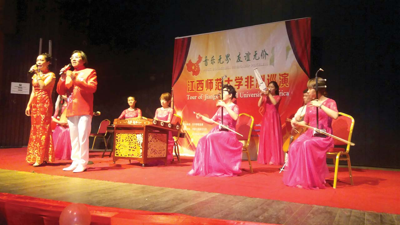 Students of Jiangxi Normal University, China, performing folk songs with traditional Chinese musical instruments at University of Lagos, as part of the university's African tour to deepen Chinese culture
