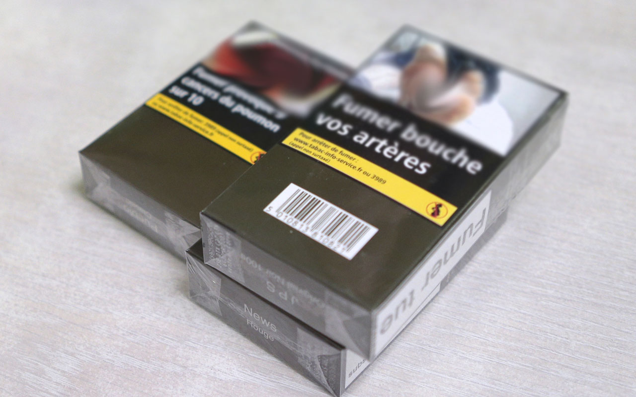 cigarette packs in Ajaccio, on the French Mediterranenan island of Corsica. Smoking cost the world economy more than 1.4 trillion USD (1.3 trillion euros) in 2012, and gobbled up a twentieth of health care spending, said a study on January 31, 2017. The killer habit consumed the equivalent of nearly two percent of global economic output or GDP, it said, with almost 40 percent of the burden falling on developing countries. / AFP PHOTO / PASCAL POCHARD-CASABIANCA