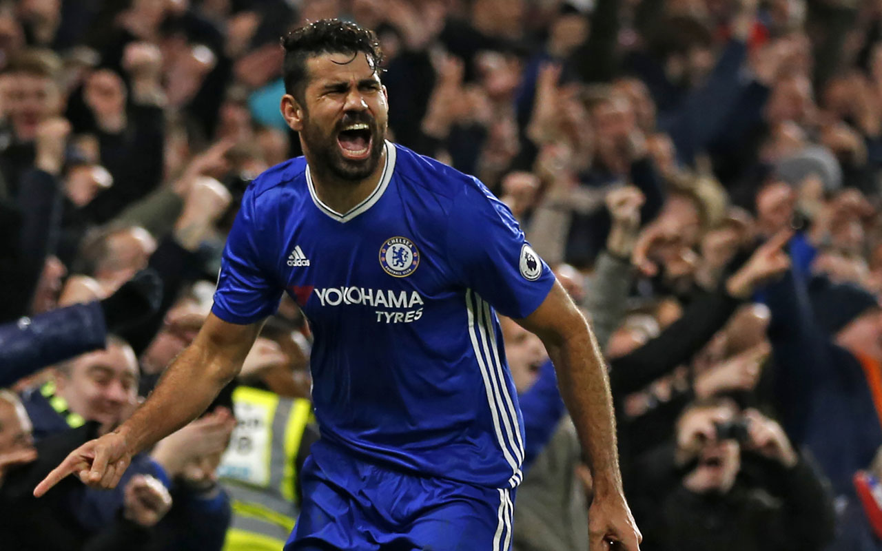 Chelsea's Brazilian-born Spanish striker Diego Costa celebrates after scoring their fourth goal during the English Premier League football match between Chelsea and Stoke City at Stamford Bridge in London on December 31, 2016. Chelsea won the game 4-2. / AFP PHOTO / Ian KINGTON /