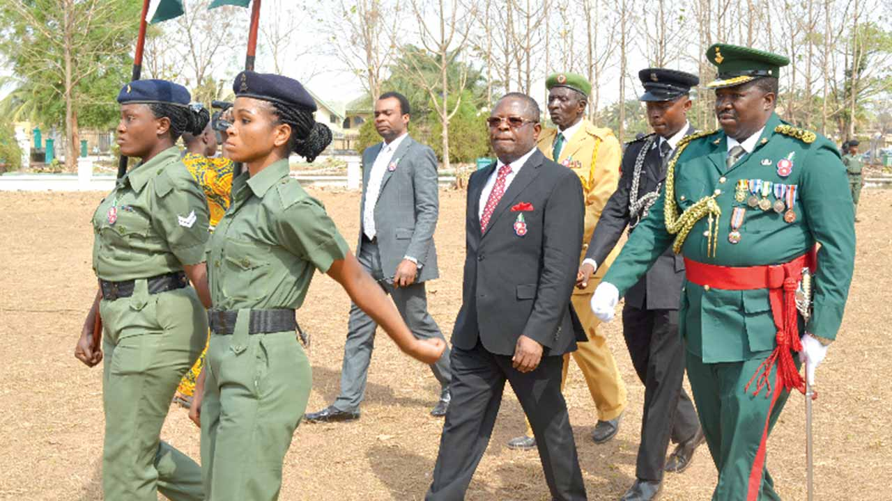Governor David Umahi of Ebonyi State (middle), Commandant, Nkwagu Military Cantonment, Patrick Kulawe (right) and others in Abakaliki.