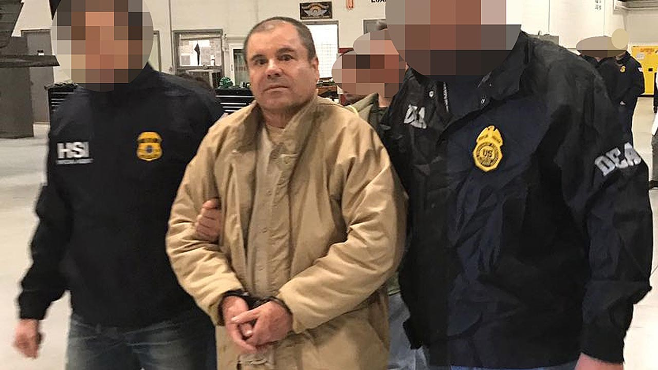 "This handout picture released by the Mexican Interior Ministry on January 19, 2017 shows Joaquin Guzman Loera aka ""El Chapo"" Guzman (C) escorted in Ciudad Juarez by the Mexican police as he is extradited to the United States. Mexican drug baron Joaquin ""El Chapo"" Guzman, one of the world's most notorious criminals, was extradited to the United States on January 19, 2017 to face charges. - Pixelation of faces was done by the Mexican Interior Ministry HO / INTERIOR MINISTRY OF MEXICO / AFP"