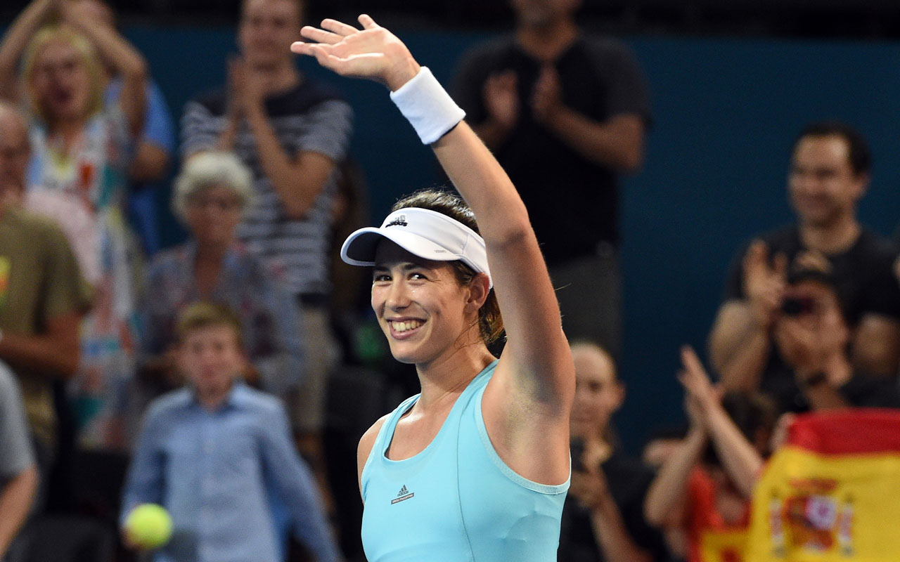 Garbine Muguruza of Spain celebrates her victory over Daria Kasatkina of Russia in their women's second round match at the Brisbane International tennis tournament in Brisbane on January 3, 2017. / AFP PHOTO / SAEED KHAN /