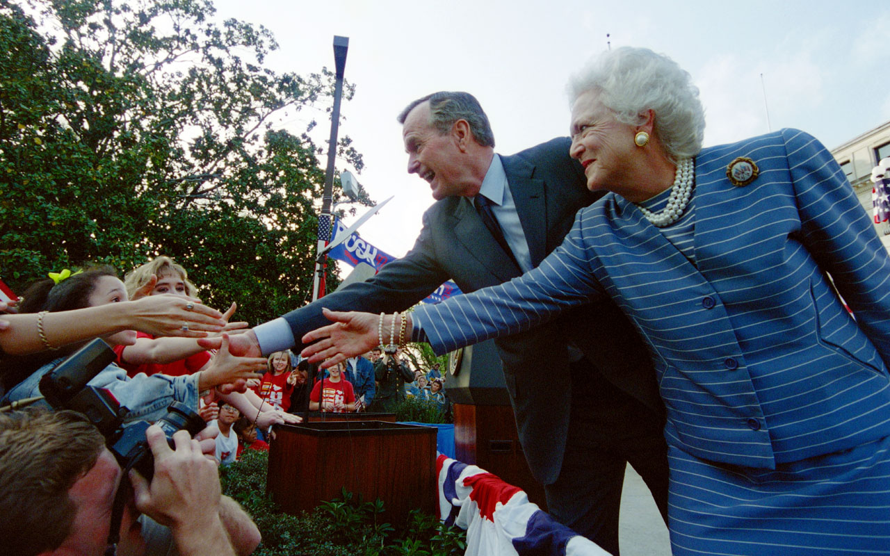 "(FILES) This file photo taken on March 6, 1992 shows former US President George Bush and First Lady Barbara Bush as they shake hands with members of the crowd at a ""Bush/Quayle 92"" rally on the steps of the Mississippi State Capitol. Former US president George H.W. Bush on January 17, 2017 was admitted to an intensive care unit in Houston, suffering from pneumonia, Bush's office said, adding that wife Barbara Bush has also been hospitalized. The 92-year-old ex-president, who was initially hospitalized on Saturday, was moved to intensive care ""to address an acute respiratory problem stemming from pneumonia,"" Bush's office said in a statement. / AFP PHOTO / LUKE FRAZZA"