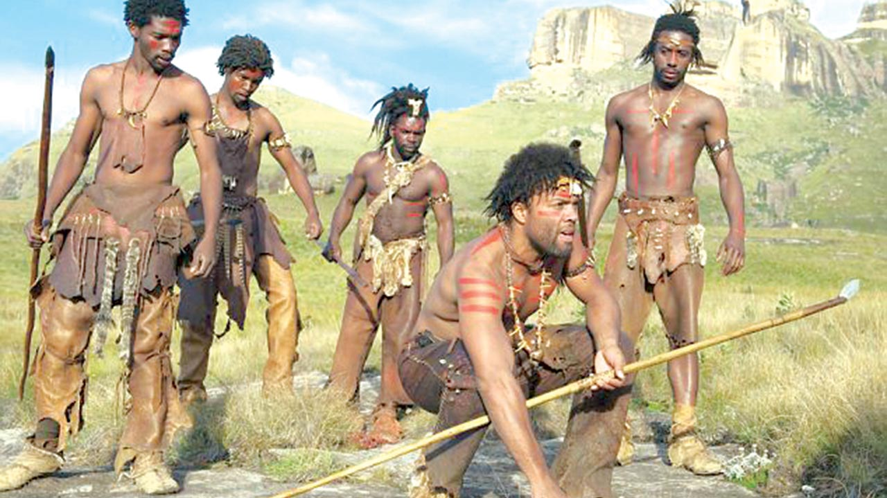 This way chaps! A human hunting party imagined for the BBC series Planet of the Apeman. New genetic analysis has once again changed the date of our ancestors initial journey from the fertile plains of Africa PHOTO CREDIT: DailyMailUK Online