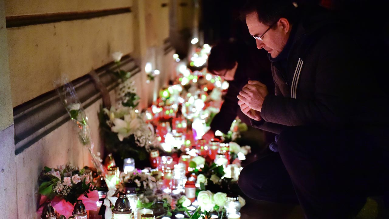 Candles and flowers are placed at the Szinyei Merse Pal High-school in Budapest on January 21, 2017, to commemorate the victims of a bus accident in Italy. At least 16 people died when a coach bringing Hungarian teenagers home from a skiing trip crashed and burst into flames on a northern Italian motorway overnight, authorities said on January 21. Emergency workers said that the bus carrying 56 people returning from France, most of them teenagers aged 14-16, as well as several teachers and two drivers, ploughed into a bridge pillar. ATTILA KISBENEDEK / AFP