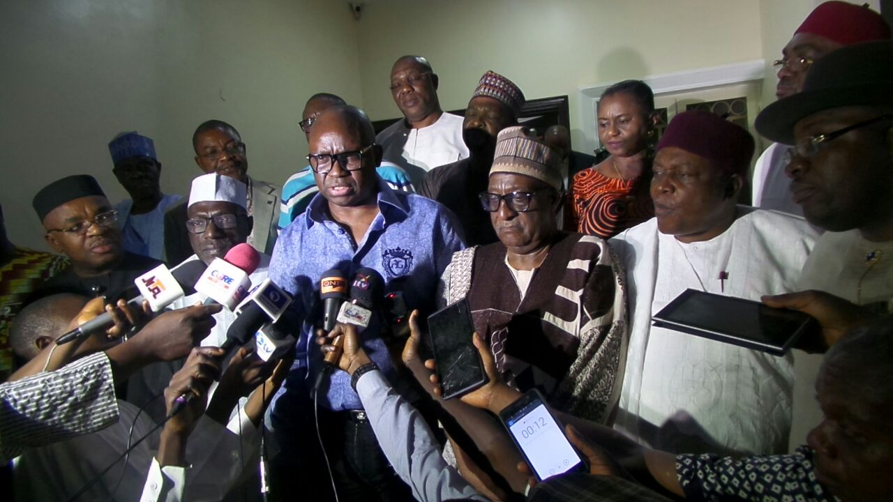 Governor Ayo Fayose of Ekiti State (C) talking to newsmen after his election as the chairman of PDP governors' forum.