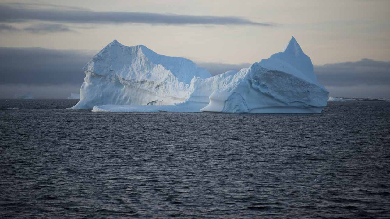 (FILES) This file photo taken on March 2, 2016 shows an iceberg in the western Antarctic peninsula. A reported pause in global warming between 1998 and 2014 was false, according to US-British research published January 4, 2017 that confirmed the findings of a controversial US study on ocean warming. Scientists at the University of California, Berkeley, and the University of York, England, corroborated the results of the National Oceanic and Atmospheric Administration's (NOAA) research paper in 2015.Their findings were reported in the US journal Science Advances. EITAN ABRAMOVICH / AFP