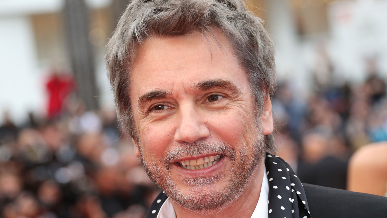 "(FILES) This file photo taken on May 13, 2016 shows French composer Jean-Michel Jarre arriving for the screening of the film ""Ma Loute (Slack Bay)"" at the 69th Cannes Film Festival in Cannes, southern France. Electronic music pioneer Jean-Michel Jarre has made history for decades by putting on some of the world's largest concerts. He will soon break new ground -- by touring North America. Jarre on January 23, 2017 announced his first-ever tour of the United States and Canada to begin on May 9 in Toronto. The nine dates will include New York's Radio City Music Hall. The 68-year-old French composer is a longtime visitor to North America where he is influential in music circles but remains far better known commercially in Europe. Valery HACHE / AFP"