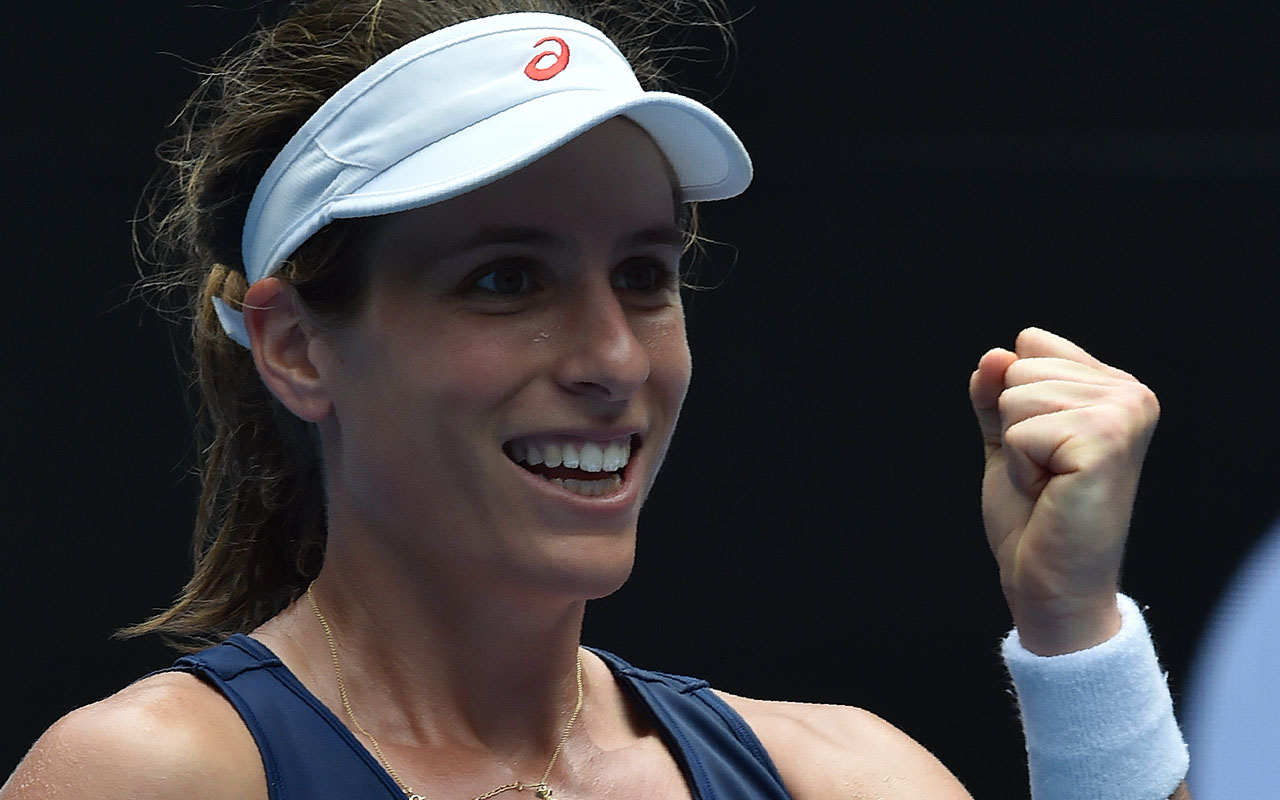 Johanna Konta of Britain celebrates her win against Russia's Ekaterina Makarova during their women's match in the fourth round on day 8 of the Australian Open tennis tournament in Melbourne on January 23, 2017. / AFP PHOTO / PAUL CROCK /