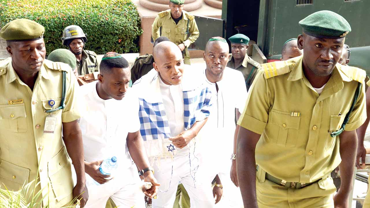 Leader of the Indigenous People of Biafra (IPOB), Nnamdi Kanu (second right) arriving at the Federal High Court for his trial in Abuja. 				PHOTO: LUCY LADIDI ELUKPO