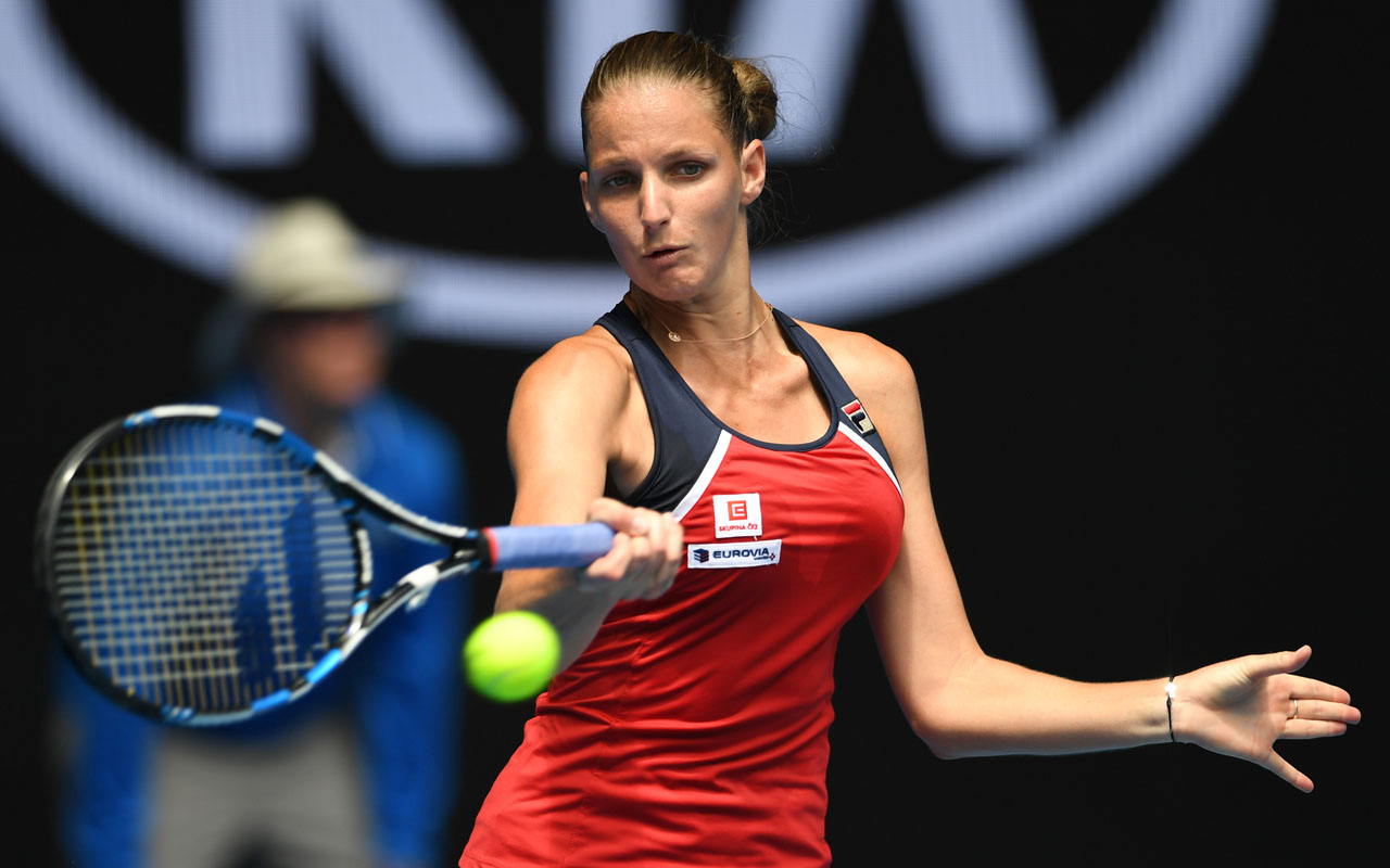Czech Republic's Karolina Pliskova hits a return against Spain's Sara Sorribes Tormo during their women's singles match on day two of the Australian Open tennis tournament in Melbourne on January 17, 2017. / AFP PHOTO / GREG WOOD /
