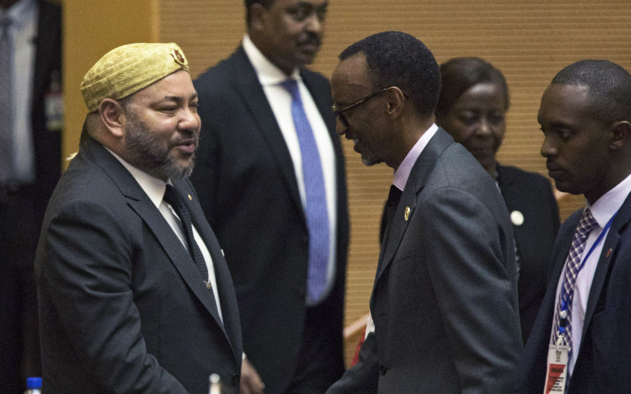 King of Morocco Mohammed VI (L) greets Rwanda's President Paul Kagame in the main plenary of the African Union in Addis Ababa on Jan 31, 2017. Morocco's King Mohammed VI took a seat at the African Union headquarters Tuesday for the first time in 33 years after being re-admitted by the bloc. Morocco's return to the fold comes a day after 39 of the AU's 54 member states agreed to allow Morocco back in the fold, despite stiff resistance from countries such as South Africa and Algeria over the status of Western Sahara. / AFP PHOTO / ZACHARIAS ABUBEKER