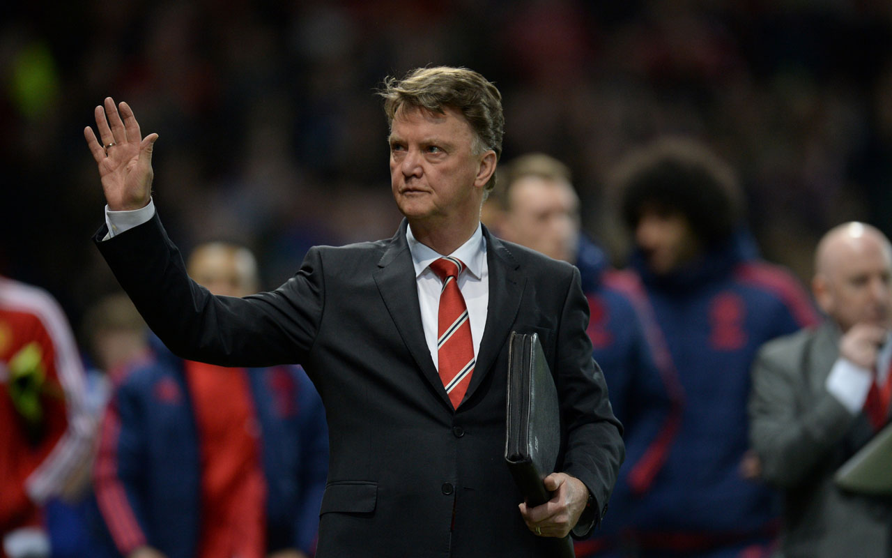 "Manchester United's Dutch manager Louis van Gaal waving as he walks out onto the pitch for the English Premier League football match between Manchester United and Chelsea at Old Trafford in Manchester, north west England. Firebrand manager Louis van Gaal has announced his retirement from professional football after more than three decades, citing ""family reasons,"" a Dutch newspaper reported on January 17, 2017. / AFP PHOTO / OLI SCARFF"