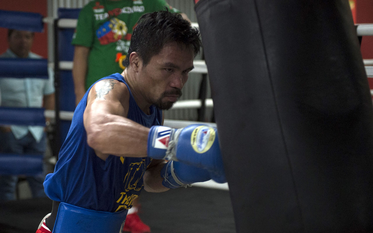 Philippine boxer Manny Pacquiao training at a gym in Manila. WBO welterweight world champion Manny Pacquiao is willing to square up with mixed martial arts star Conor McGregor if his potential superfight with Floyd Mayweather fails to materialise, a spokesman said on January 22, 2017. / AFP PHOTO / TED ALJIBE