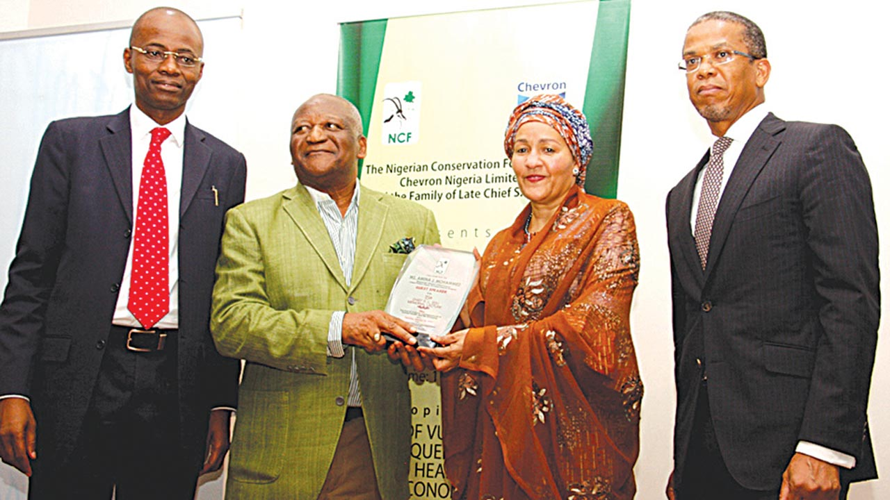 Guest Speaker and Honourable Minister of Environment, Ms Amina Mohammed OFR (2nd right) receiving an award of Honour from Chairman of the occasion and Founder, Fight Against Desert Encroachment (FADE), Dr Newton Jibunoh (2nd left), with Chairman of the Council, Nigerian Conservation foundation (NCF), Chief Ede Dafinone (right) and Director General, NCF, Mr. Adeniyi Karunwi (left), at the 15th Chief S.L Edu Memorial Lecture organised by NCF in Lagos