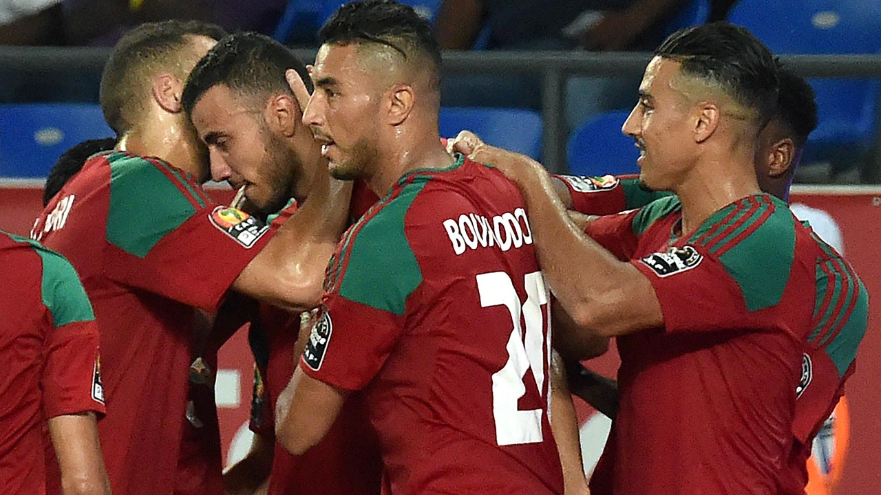 Morocco's midfielder Romain Saiss (2nd-L) celebrates with teammates after scoring a goal during the 2017 Africa Cup of Nations group C football match between Morocco and Togo in Oyem on January 20, 2017. ISSOUF SANOGO / AFP