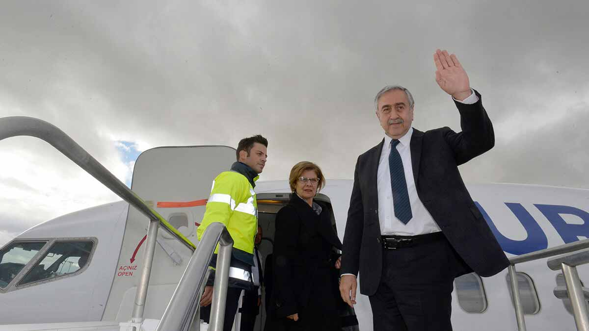 A handout picture released by the Presidency of the self-proclaimed Turkish Republic of Northern Cyprus (KKTCB) on January 8, 2017, shows Turkish Cypriot leader Mustafa Akinci (R) waves as he boards a plane at Ercan Airport in in the self-proclaimed Turkish Republic of Northern Cyprus . Akinci and Cypriot President Nicos Anastasiades of the internationally-recognised Greek Cypriot Republic of Cyprus are due to meet in the Swiss city for talks from Monday in a bid to give new momentum to the process. STRINGER / KKTCB / AFP