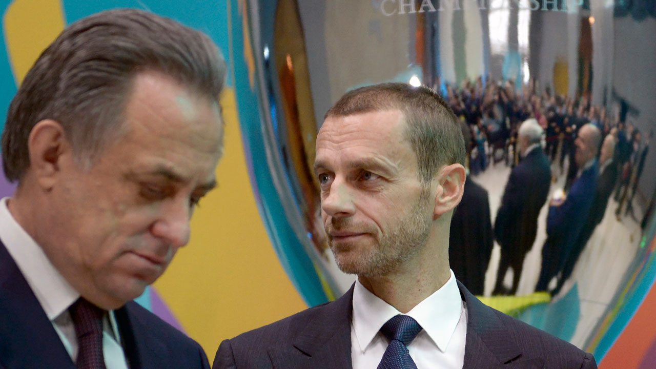 Russia's deputy prime minister Vitaly Mutko (L), who also serves as the president of the Russian Football Union, and UEFA President Aleksander Ceferin attend the launch of the Saint Petersburg's logo for the Euro 2020 football tournament in Saint Petersburg on January 19, 2017. The EURO 2020 UEFA European Championship will see matches hosted in 13 cities across Europe, with the semi-finals and final staged at Wembley Stadium in London in July 2020. Olga MALTSEVA / AFP