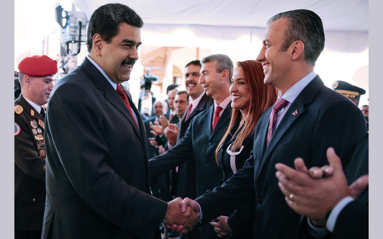 Maduro on January 4, 2017 named Tareck El Aissami as his new vice-president, who would take over from him if he were removed from office this year as the opposition demands. Maduro said in a televised address that he had named El Aissami, 47, a powerful state governor, to the post for the 2017 to 2018 period. / AFP PHOTO / Venezuelan Presidency / HO /