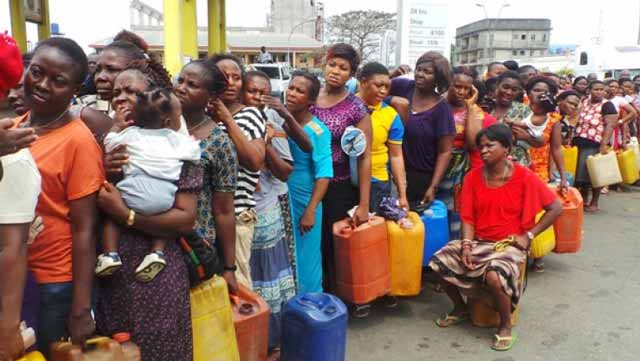 A long queue of persons waiting to buy kerosene