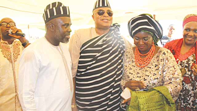 Ogunshakin (middle) and his wife, Chinyere