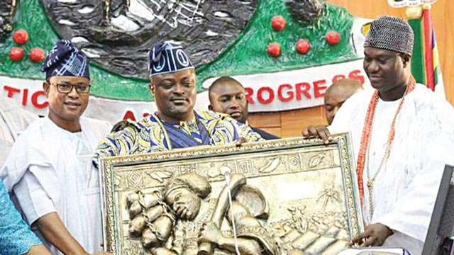 Ooni of Ife (right) receiving an artwork from the Speaker, Lagos House of Assembly