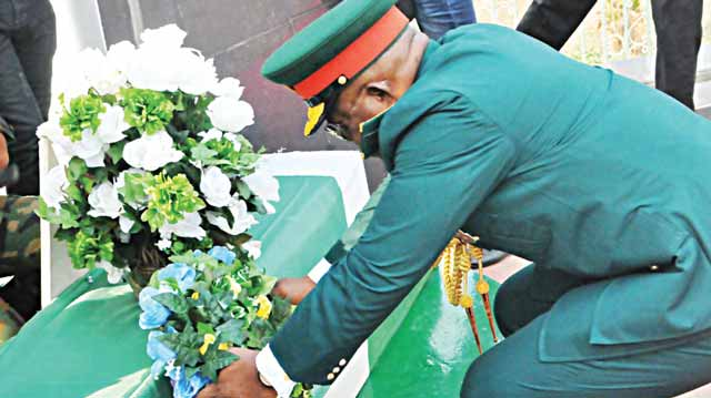 General Officer Commanding (GOC) 2 Division Nigerian Army, Maj.-Gen. Matians Abraham, laying flowers at the Remembrance Arcade at Agodi, Ibadan, Oyo State… yesterday. 							              PHOTO: NAJEEM RAHEEM