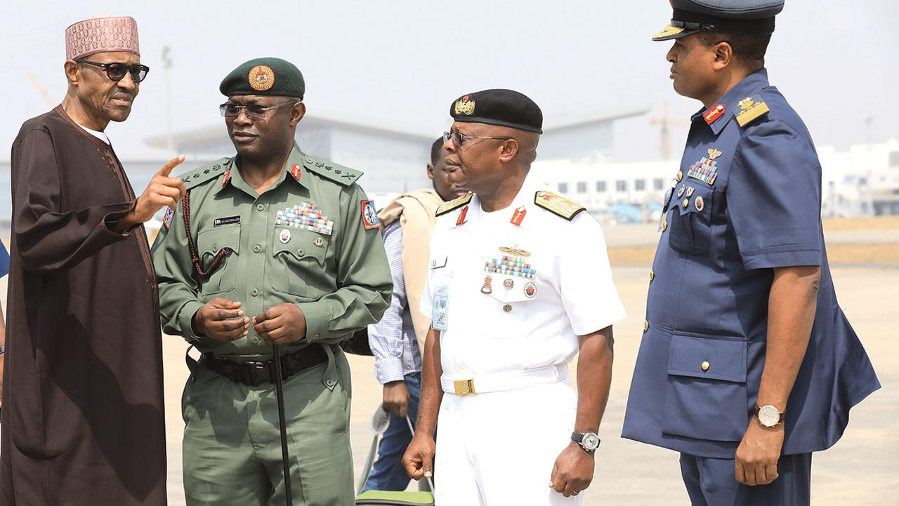 President Muhammadu Buhari (left), Chief of Defence Staff, Major-General Abayomi Gabriel Olonishakin, Chief of Naval Staff, Vice Admiral Ibok-Ete Ekwe Ibas and Air Marshal Sadique Abubakar before departure at Nnamdi Azikiwe International Airport Abuja to London on a 10-day vacation…yesterday. PHOTO: PHILIP OJISUA