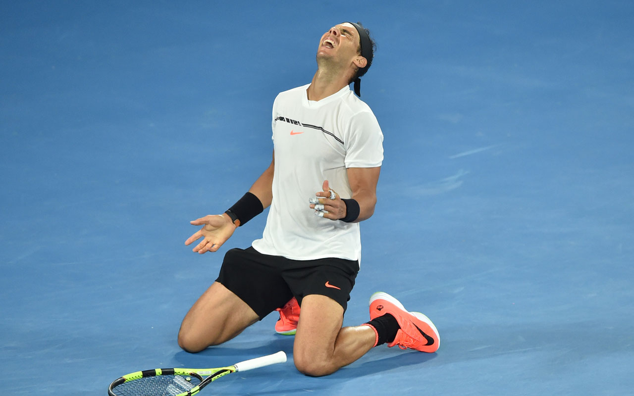 Spain's Rafael Nadal celebrates his victory against Bulgaria's Grigor Dimitrov during their men's singles semi-final match on day 12 of the Australian Open tennis tournament in Melbourne on January 28, 2017. / AFP PHOTO / PETER PARKS /