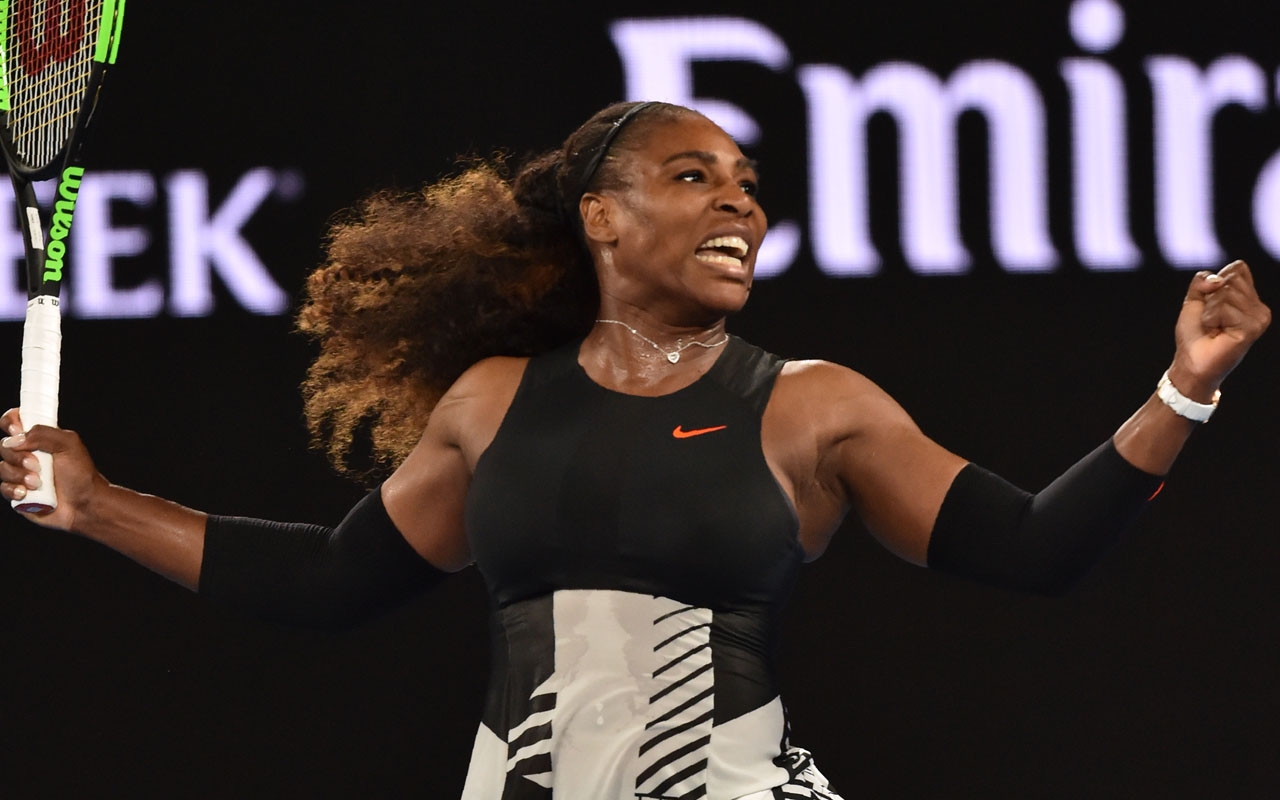 Serena Williams of the US celebrates after victory against Czech Republic's Lucie Safarova during their women's singles second round match on day four of the Australian Open tennis tournament in Melbourne on January 19, 2017. / AFP PHOTO / PAUL CROCK /