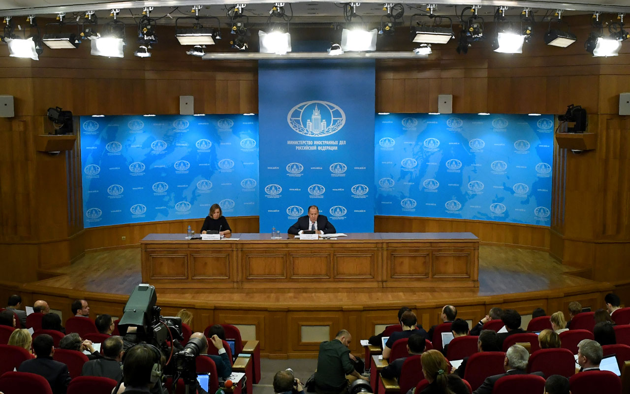 Russian Foreign Minister Sergei Lavrov, accompanied by Foreign Ministry spokeswoman Maria Zakharova, gives his annual press conference in Moscow on January 17, 2017. Sergei Lavrov said on January 17 that one of the goals of upcoming Syria peace talks in the Kazakh capital was to consolidate the frail truce in the war-torn country. / AFP PHOTO / Kirill KUDRYAVTSEV